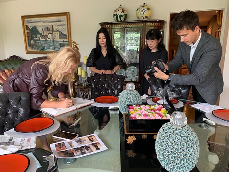 Mrs. Monika Babisova signs a guest book.